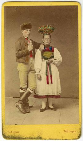 [Hand-colored carte-de-visite depciting a woman and man in ethnic costume]