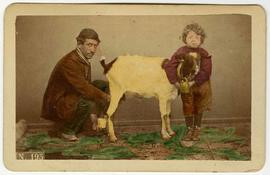 [Hand-colored carte-de-visite depciting a man and a boy with a goat]